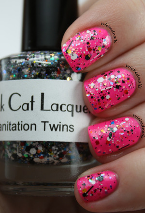 This is Black Cat Lacquer's Sanitation Twins over Kleancolor Neon Pink.  Shimmery sparkly glitter! blackcatlacquer.com
