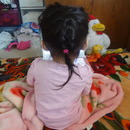 My little sister's hair is getting long !