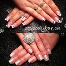 Top- acrylic French black & neon pink. Bottom- baby pink sparkle gel polish on clear acrylic