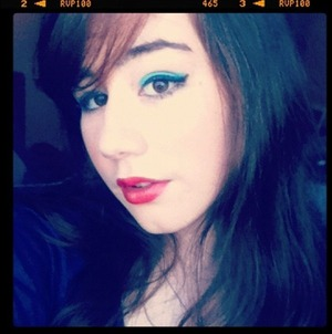 I was inspired to do this look by the old Barbie dolls who had the blue eye shadow and bright red lipstick .