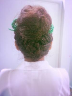 Upside down Dutch braid w/ a bun done by Emily.