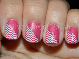 Pink and white manicure using stamping.