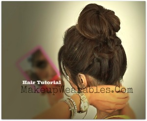 Braided ponytail into a perfect messy bun hair tutorial can be found here. <3