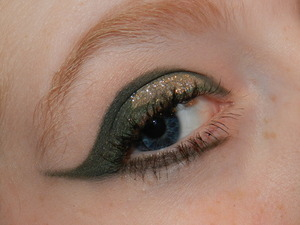 My dramatic greens look! All products used listed on my blog: http://ginger-glam.com/2012/01/02/dramatic-greens-an-eye-look/