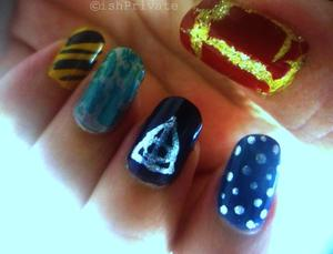 One nail for each House, middle one is the Deathly Hallows symbol.