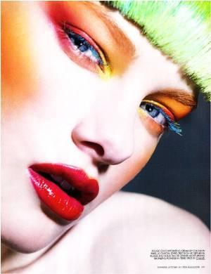 green hair, orange eyeshadow, red eyeshadow, blue mascara, red glossy lip, orange blush