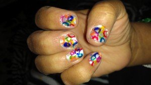 White background with different colors. Ito get the circle.effects dip a straw in the color of your choice then press to nail. Sorry for the mess around the nails I know I need to clean up