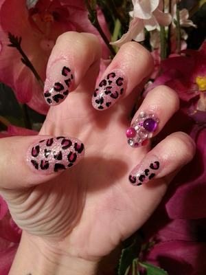 pink acrylic mix with blk and pink cheetah print and pink,clear purple stones