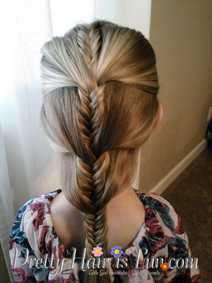 A fishtail braid that travels down the head and incorporates large sections of the hair at a time.