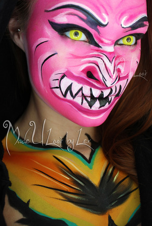 Dragon themed face paint, with inspiration drawn from a mask featured in the carnival in Bolivia. Find me on Facebook: www.facebook.com/madeulookbylex, also find me on youtube, www.youtube.com/madeyewlook