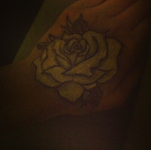 When I'm bored, I draw crappy roses on myself with makeup