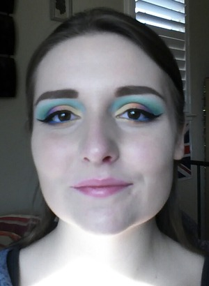 A colorful Mardi gras look! Products not listed: Hot Topic turquoise eyeliner pencil. Colors are actually much more vibrant than pictured.