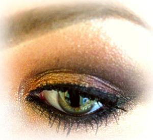 A smokey eye using gold, brown and black.