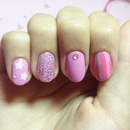 Glitter and pink stripes.