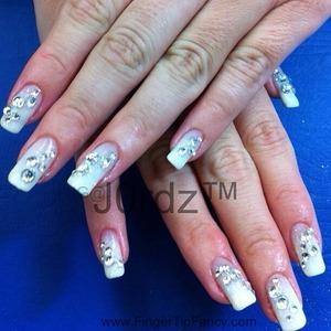 DETAILS HERE:  http://fingertipfancy.com/white-swarovski-rhinestone-nails
