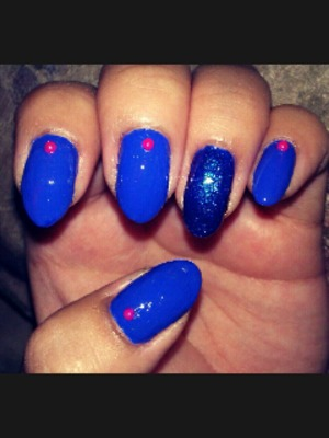 bright blue nails with a glitter accent and hot pink pearls!! :)