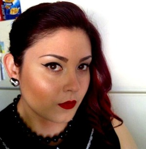 I decided to really amp up my look today for work with a dramatic cheek and matte lip. I created a simple cat eye with E.L.F.'s liquid liner. I swept my hair to the side with a twist, pinned it, curled some loose waves to frame my face, and to add texture/volume.  I used large heart earrings with a silver bow, a black faux pearl necklace, and a black sleeveless top with a peter pan style collar.  This might be a bit too much for some work environments, but why not give it a go.  I think it looks clean, professional, put together, and is very simple/easy to accomplish.  It could really make you stand out in a good way!  Kudos to my kitchen, and my favorite Honey Bunches of Oats with Almonds cereal!!    P.S. I used Goldwell Tophic permanent hair color in 6VV with 20 volume developer (6%) as my base color.  I then use Manic Panic in Vampire Red to pump it up!