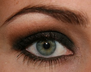 Just did a very black smokey eye. This look is perfect for a night out on the town. I added a little bit of a glittery shadow on top of the very black one to make it pop a little more.