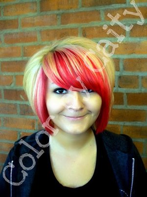 Beautiful blonde hair with a bright red perimeter. LOVE IT!