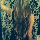 Long, wavy hair.