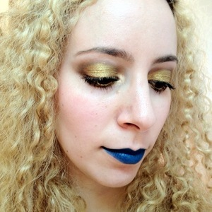 This is a look I wore to hit the mall and get some Inglot shadows and such. I recently got a few more OCC lip tars and I really wanted to do a glittery gold eye using Eye Kandy Bananarama and Sugarpill Goldilux with a blue lip.   I also tried a different way to get a glittery eye by mixing the Eye Kandy glitter in with the gold pigment using the Glitter adhesive as a mixing medium and it worked really well.