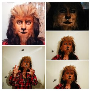 Some homemade fake fur (teased yarn and spirit gum- lots of flipping spirit gum) and face paint/foundation/eyeliner.
