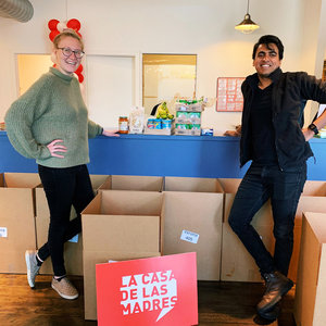 La Casa team members assembling food boxes to support 150 women in permanent supportive housing.