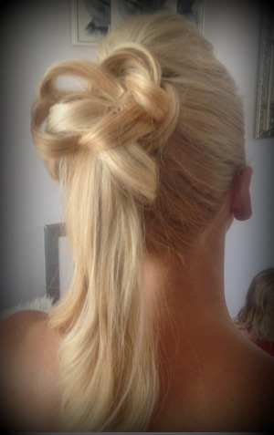 Detail added with clients own hair to modernise the every day ponytail