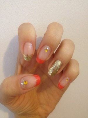 Orange coral French tips with some glitter and bling