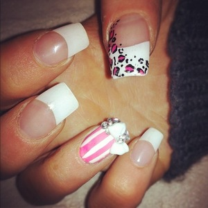 acrylic nails, with leopard print and striped embellished feature nails