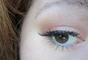 One of my favorite color combos: copper shadow with a pop of teal eyeliner