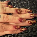 Opulent. red and gold matte finish nails!