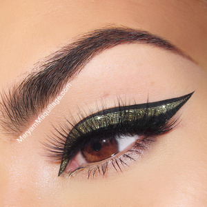 TUTORIAL: http://www.maryammaquillage.com/2013/11/glitter-border-liner-for-holidays.html