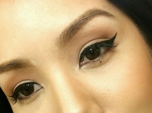 Create that perfect winged liner using: - MAC gel liner (Blacktrack) - MAC brush (210 and 266)