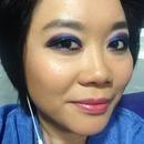 Blue glitter and purple smokey eye