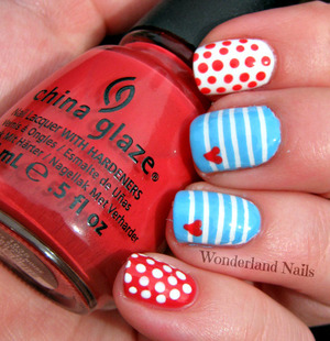 For more info please visit my blog http://wonderland-nails.blogspot.com/2013/06/nautical-themed-nails.html