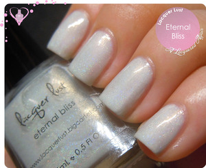 Swatch of indie polish Lacquer Lust Eternal Bliss, a subtle, soft dove white holo. More photos and review on http://www.alacqueredaffair.com/Lacquer-Lust-Eternal-Bliss-29129831