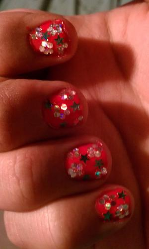 Pink base color with holographic flowers with holographic stars.