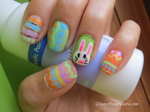 http://superbeautyguru.com/spring-makeup-using-analogous-colors-and-double-winged-liner This Easter nail look uses pastel colors to create an adorable Easter egg and Easter bunny nail look. I used nail paint and striping tape along with nailpolish to do these nails, and have a video tutorial on my blog.