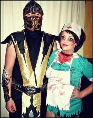 This is my bf Daniel & I for a dress up party when I first started doing special effects makeup - its so bad compared to how i am now but its funny to look back and see how much you've improved. Like that sliced throat is ridiculously wide haha