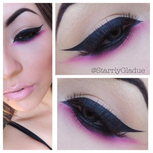 I used a black cake liner to create the bold winged liner on top with MAC's 210 bush.. and used MAC Smolder eye kohl on the bottom blended out with MAC's Carbon & Sugarpill's Dollipop :)