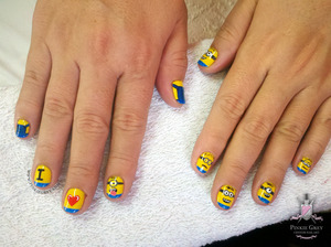 My client wanted these cuties on her nails! We added a purple minion a week after. =P