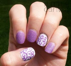 http://www.thelittlecanvas.com/2013/05/zoya-stevie-curly-q-nail-art.html