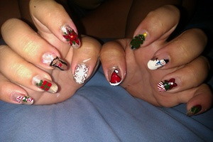 Christmas Nails! Candy Cane, Present, Rudolph the Red Nose Reindeer, Poinsettia Flower, Snowflake, Santa Hat, Christmas Tree, Frosty the Snowman, Presents, and Mistletoe