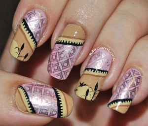 so i used a nail art image plate for the design on the pink...the cream tan design is inspired by a stamp i found on google images so i hand painted that design onto my nails