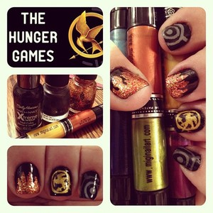My Hunger Games inspired manicure for the premiere for Thursday/Friday! #TheHungerGames