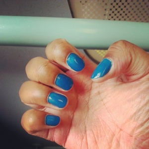 Short round nails accompanied by a royal blue nail varnish colour. Nail varnish is Barry M.