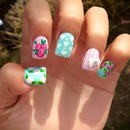 Flowered Nail design with pearl bow