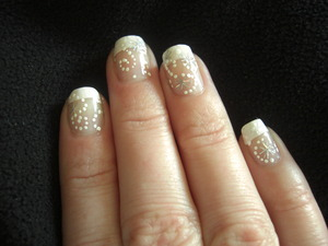A basic french tip with foil star-bursts trailing white dots. I wanted to create something simple yet beautiful.