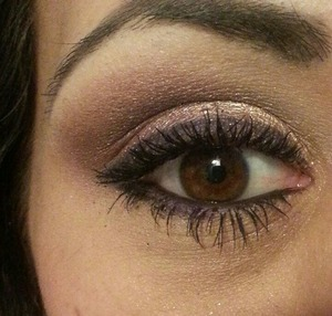 My eye makeup for this past Valentine's Day.  I went with Half Baked Eyeshadow by Urban Decay(shimmery gold) on my inner lid with a matte brown in my crease.  I used Last Call by U.D. (a shimmery maroonish pink) on my outer lids and brought that up to meet the matte white color for my brow highlight.  I finished it with Plum Eyeliner from Smashbox and a few coats of mascara by Urban Decay.  Oh, and I ran Smog by U.D. under my lower lash line along with the eyeliner from Smashbox.